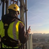 High tower with worker on it
