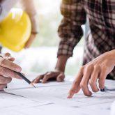 2 men looking at blueprints