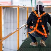 Man on scaffold in safety harness