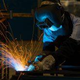Man welding in welding mask