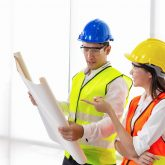 Man and woman looking at blueprints